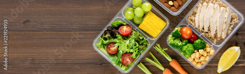 Obraz na plátně Healthy ready to eat food in meal boxes on wood banner background