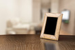 canvas print picture - old photo frame on the wooden table
