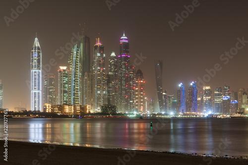 Poster Violet Beautiful night view of Dubai Marina and the Skyscrapers, Dubai, United Arab Emirates