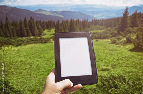 Fotografía  Close-up Of Human reading e-book in nature