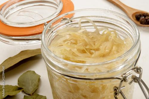sauerkraut in a glass jar with bayleaf