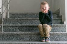 A Small Boy In A Black T-shirt...