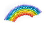 Fototapeta Tęcza - Rainbow of multicolored candy dragees on white background