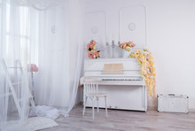 White Interior Of A Photo Studio With An Old Upright Piano In The Center