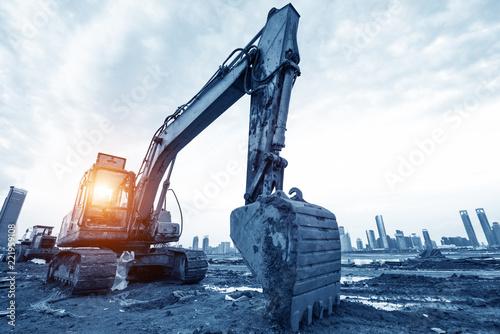 Fotografie, Obraz excavator in construction site on sunset sky background