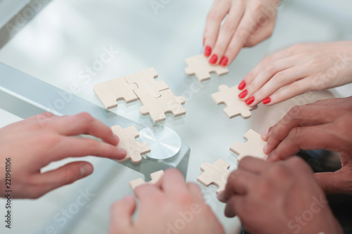 Fototapety, obrazy: closeup.business partners accounting for the puzzle pieces