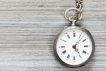 Retro Pocket Watch On Gray Wooden Table
