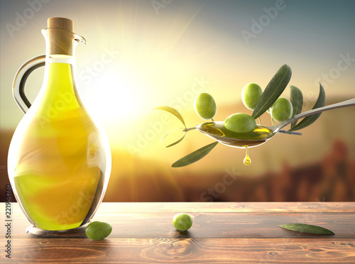 Spoed Foto op Canvas Aromatische Olive oil and an olive branch in a spoon and a bottle of oil