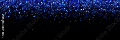 Fényképezés  Lilac glittering particles on black background, wide banner
