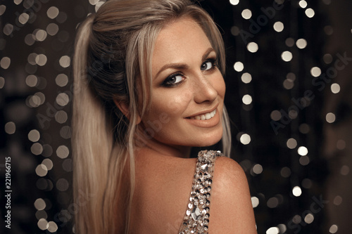 Beautiful happy blonde woman portrait laughing at camera