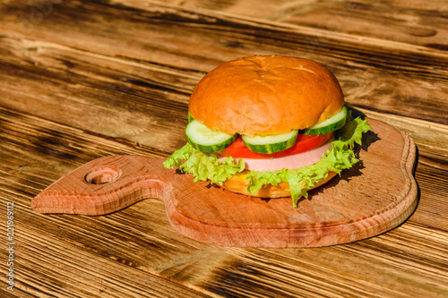 Fresh hamburger on the rustic wooden table