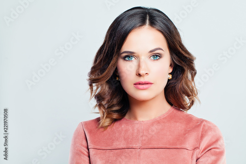 Fotografie, Obraz Elegant woman brunette with curly hair and makeup on white banner background, fa