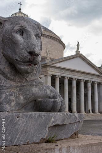 Fotografia, Obraz  Piazza Plebiscite, Naples, Italy - 06/14/2018: Lion statue in front of cathedral at Plebiscito square, Naples