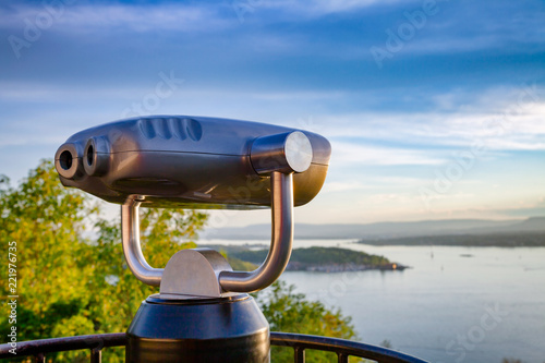 Photo  Tourist telescope over Oslo cityscape at sunset Norway