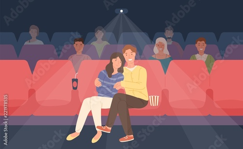 Photo Romantic couple sitting in movie theater or cinema hall and hugging