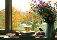 Autumn Background / Bouquet Of  Flowers, A Wooden Bird  And A  Books On The Windowsill