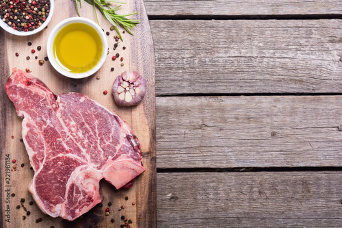 Raw beef steak T bone with ingredient