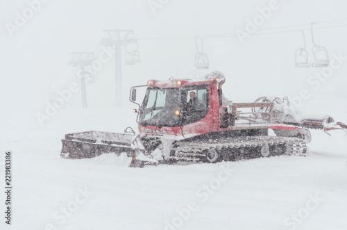 Printed kitchen splashbacks Storm Snowcat preparing a slope in high mountains at skiing resort
