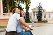 Portrait of a smiling young couple riding on a motorbike