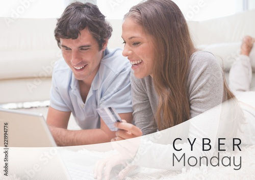 Cyber Monday Sale Couple lying in front of laptop with