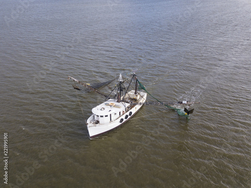 Aerial close up view of shrimp boat at sea