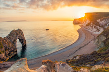 Landscape Of Empty Durdle Door Beach At Sunset. Dorset England.