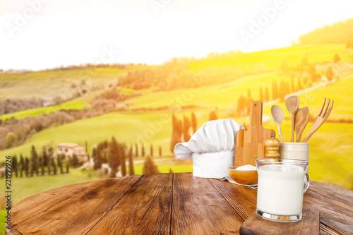 Fotobehang Zwavel geel kitchen accessories in autumn Tuscany on a brown table