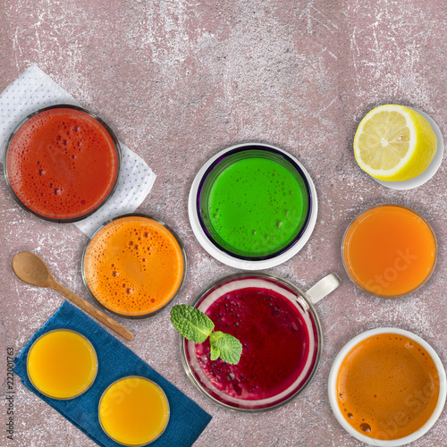 Garden Poster Juice Set of different vegetable juices and fruit drinks, mint leaf and lemon on pink stone background. Concept of healthy eating and drinks. Top view. Copy space.