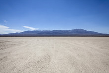 Mojave Desert Dry Lake With Mountain Backdrop Near Death Valley In California.