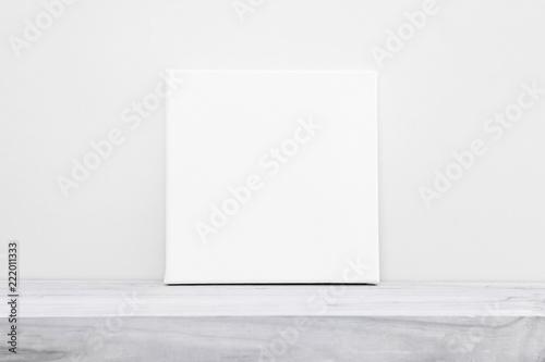 Fototapeta Mock-up poster frame. Blank square canvas on table. obraz