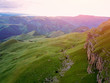 View from the drone from the air. The landscape of the valley from a plateau Bermamyt the North Caucasus at sunrise.