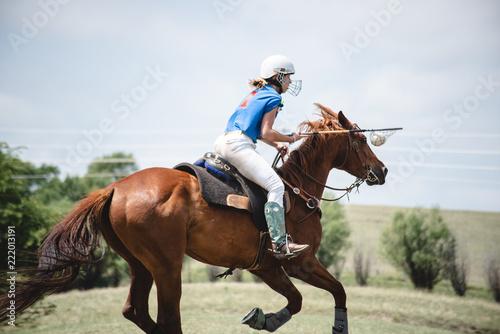 Keuken foto achterwand Paarden Woman Plays Polocrosse