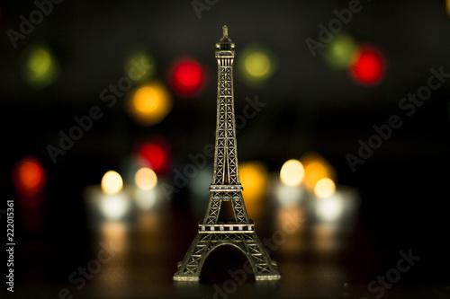Deurstickers Eiffeltoren Eiffel tower on the background of colorful lights garland, bokeh.