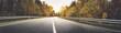 Leinwandbild Motiv asphalt road with beautiful trees on the sides in autumn