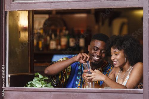 Cheerful couple making photo at restaurant