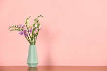 Beautiful Fragrant Freesia Flowers In Vase And Space For Text On Color Background