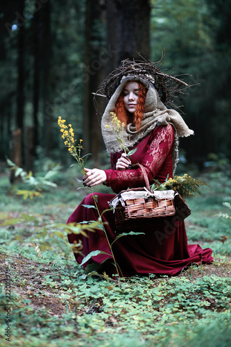 The red-haired witch holds a ritual with a crystal ball