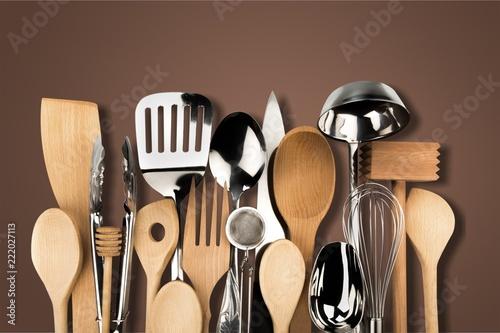 Obraz na plátne Kitchen metal and wooden utensil on  background