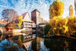Old town of Nuremberg with half-timbered houses over Pegnitz river, Germany at fall, retro toned