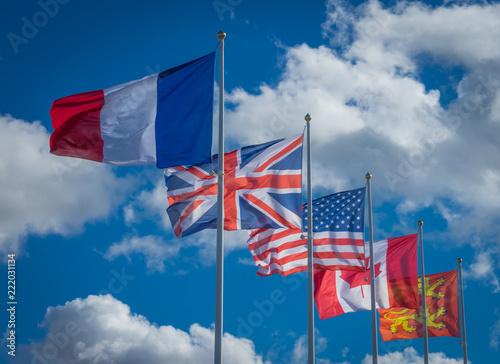Arromanches, France - 08 13 2018:  Drapeaux de la liberté depuis les falaises d' Canvas Print