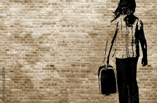 Valokuvatapetti Graffiti/shadow on a brickwall showing a refugee girl walking with her suitcase