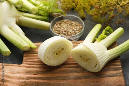 Ripe fennel bulbs on wooden cutting board