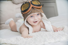 The Baby Is Dressed As A Pilot