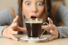Amazed Woman Looking At Coffee...