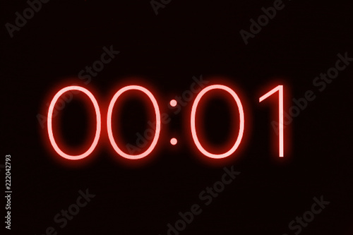 Fotomural  Digital clock timer stopwatch display showing 1 one second remaining in glowing red numbers