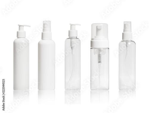 Fototapeta Set of blank cosmetic bottles close-up on white background obraz