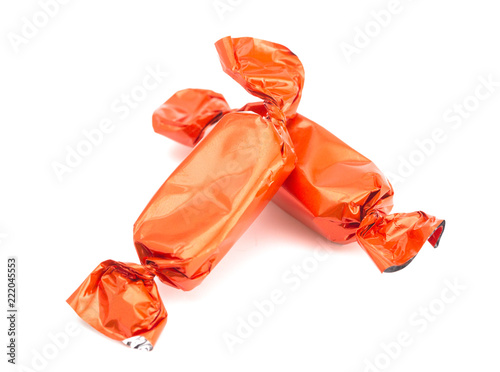 Fotografía  Orange Wrapped Candy on a White Background