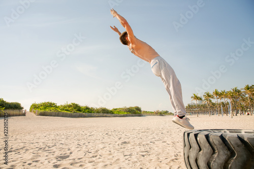 16cb7b250d2280 Fit Latino doing back flip in Miami Beach - Buy this stock photo and ...