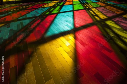 Fotografie, Obraz Rainbow colours shine on the modern city floor
