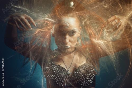 Fotomural Strong tribal woman warrior, moon goddess or a priestess